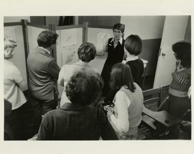 Nancy Hart instructing botanic art class in classroom