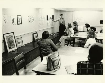 Nancy Hart teaching botanical art class in classroom