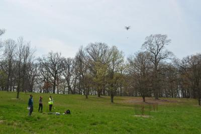 Lane Scher and undergraduate research fellows collecting pollen with a drone