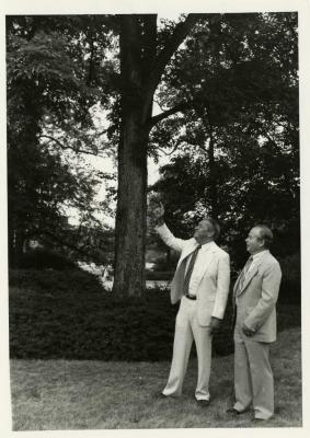 Byron Turnquest pointing at tree with George Ware during presentation of check for $125,000 to The Morton Arboretum by ARCO