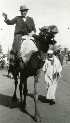 Joy Morton riding camel in Egypt