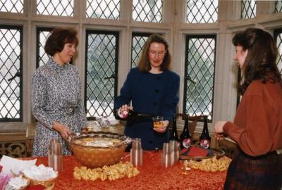 George Ware Retirement Party in Founders Room - Rita Hassert pouring plum wine with Susan Klatt (left)