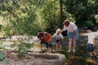 Mary Toohey and students in a stream