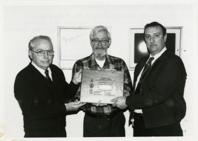 William Buckingham presenting a National Centennial Award to Web Crowley and George Ware