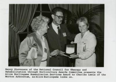 Nancy Stevenson presents Alice Burlingame Humanitarian Services Award to Charles Lewis
