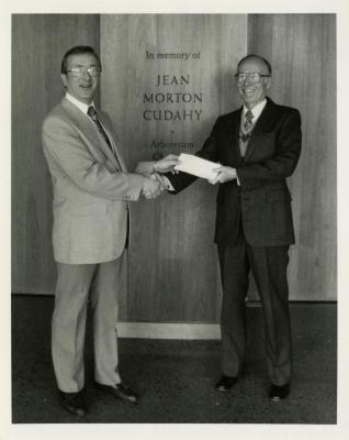 Denny Todak presenting check to Dr. Marion Hall at Administration Building