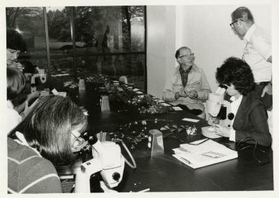 Bill Hess and class in Botany Lab examining specimens