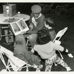 Family Fair: man reading story to children