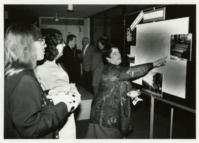 Annual Appeal: Linda Sanford reviewing information on board with donors