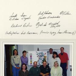 Employee Giving Committee posing with poster