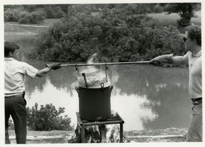 Fish Boil: Kris Bachtell (left) and volunteer cooking fish at Meadow Lake