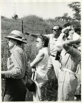 Ray Schulenberg with education class in the prairie