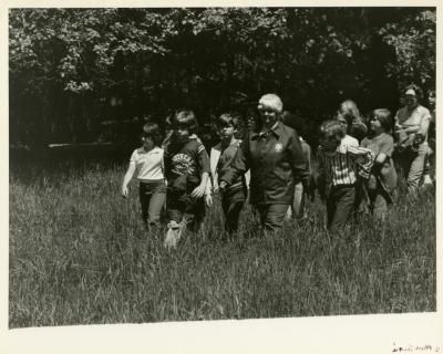Morton Arboretum Guide, Marjorie Walls, with children in the prairie