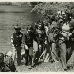 Alice Burkman leading  school group of children