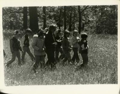 Morton Arboretum Guide, Alice Burkman, with school group of children in the woods