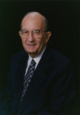 Jerry C. Bradshaw, seated portrait, black background