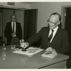 Dr. Marion Hall stamping Herbarium's 50,000th specimen