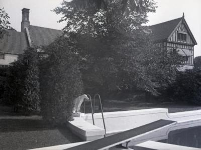Morton residence with corner of swimming pool and dog statue