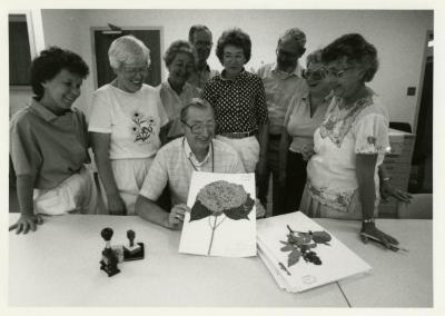 Herbarium's 75,000 accession, volunteers with Nina Podrasky (left), Bill Hess (seated), Web Crowley (standing third from R)