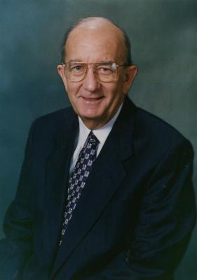 Jerry C. Bradshaw, seated portrait, blue background