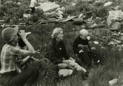 """Elizabeth """"Sody"""" Zimmerman seated in grass with other people"""