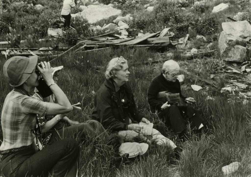 "Elizabeth ""Sody"" Zimmerman seated in grass with other people"