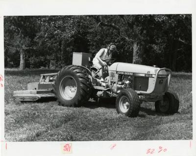Selma Caliban outdoors on woods mower