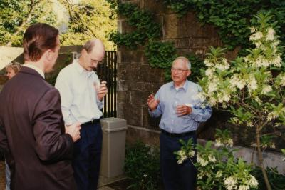 Green Nature, Human Nature book signing in Sterling Morton Library, George Ware speaking to Gary Watson and Gerry Donnelly in the May T. Watts Reading Garden