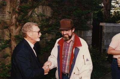 Green Nature, Human Nature book signing in Sterling Morton Library, Charles Lewis greeting Tony Byrne in May T. Watts Reading Garden