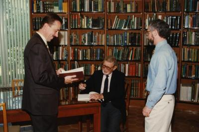 Green Nature, Human Nature book signing in Sterling Morton Library, Charles Lewis signing, Gerry Donnelly and Christopher Dunn standing