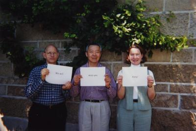 """Sterling Morton Library staff holding signs in the May T. Watts Reading Garden """"We will  miss you Addy"""""""