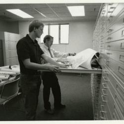 Rick Hootman and Joe Larkin reviewing maps and plans in the new Map Room