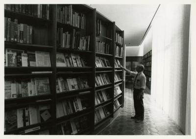 Ian MacPhail looking at periodicals in the Sterling Morton Library