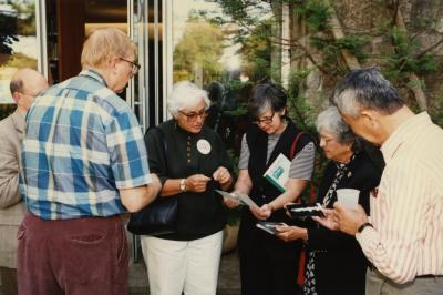 Green Nature, Human Nature book signing in Sterling Morton Library, group of guests in conversation in the May T. Watts Reading Garden