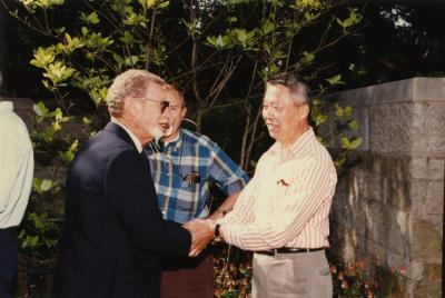 Green Nature, Human Nature book signing in Sterling Morton Library, Charles Lewis greeting Peter Wang in May T. Watts Reading Garden