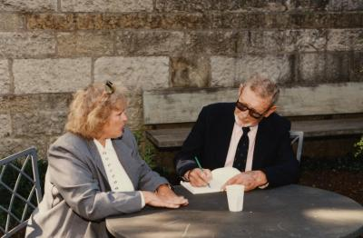 Green Nature, Human Nature book signing in Sterling Morton Library, Charles Lewis signing for Darlene Spalo in the May T. Watts Reading Garden