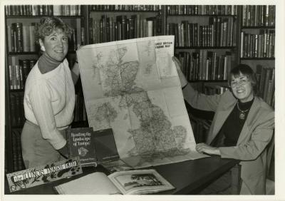 Karla Patterson (left) and Carol Doty showing map of Britain in the Sterling Morton Library