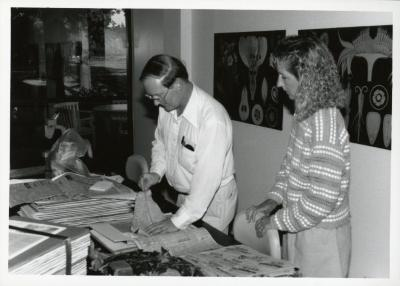 Ross Clark with woman pressing leaves in Botany Lab
