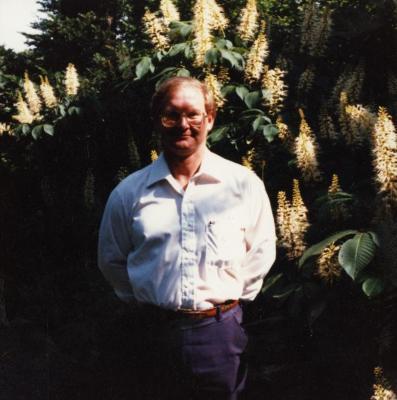 Ross Clark standing in front of bottlebrush buckeye shrub
