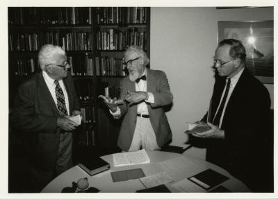 Professor Joseph Ewan speaking to two men at lecture in the Sterling Morton Library