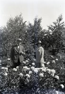 Joy and Margaret Gray Morton with peonies on Joy Path