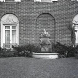 Close view of fountain and window designs at Mark Morton residence