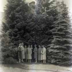 Margaret Gray Morton east of residence with seven women