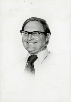 Ross Clark, smiling vignette portrait