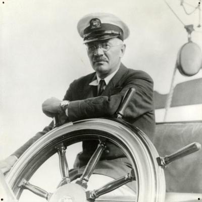 Sterling Morton behind steering wheel of yacht