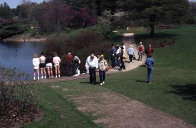 Visitors along path around Meadow Lake at Arborfest