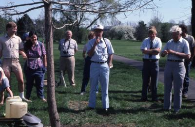 Dr. Marion Hall speaking at Arborfest tree planting with crowd