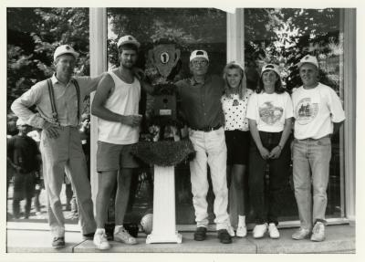 Employee picnic winning volleyball team with trophy outside Thornhill