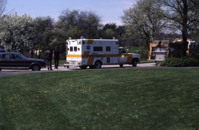 Ambulance and fire truck parked by Visitor Center at Arborfest