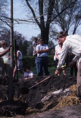 Craig Johnson planting tree at Arborfest with visitors